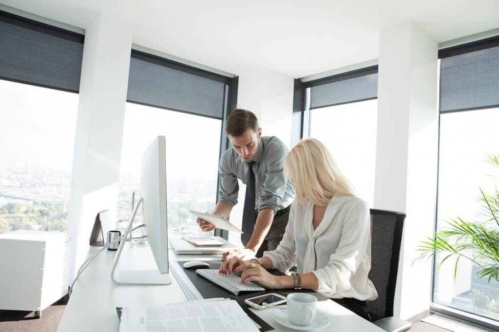 employees working together at a desk