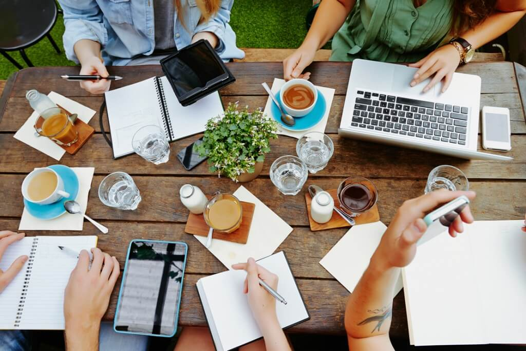 group of digital marketers around a wooden table