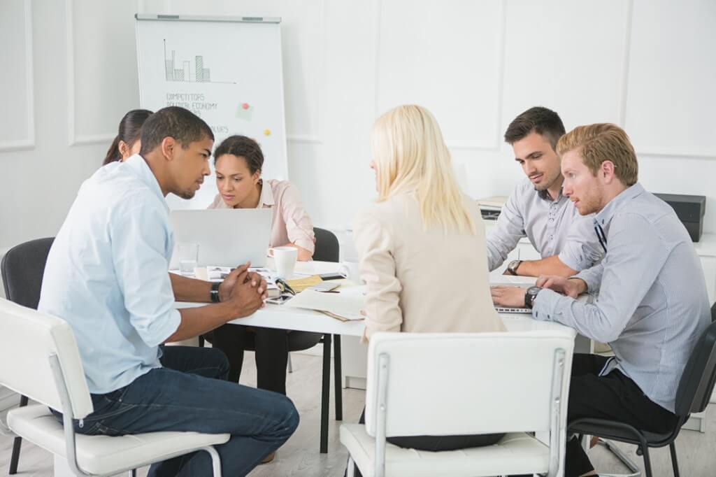 workers having a meeting in a trendy conference room