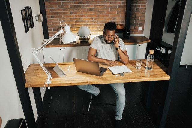 man working at desk remotely best remote jobs