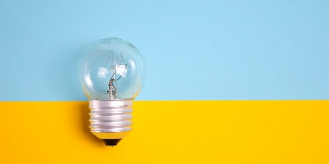 light bulb against blue and yellow background