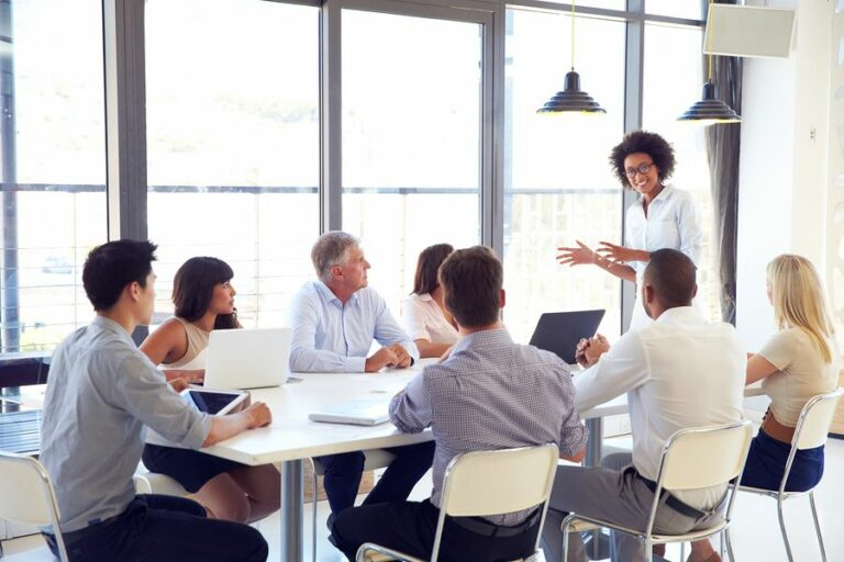 A women discussing ideas with Corporate Communications Recruiters