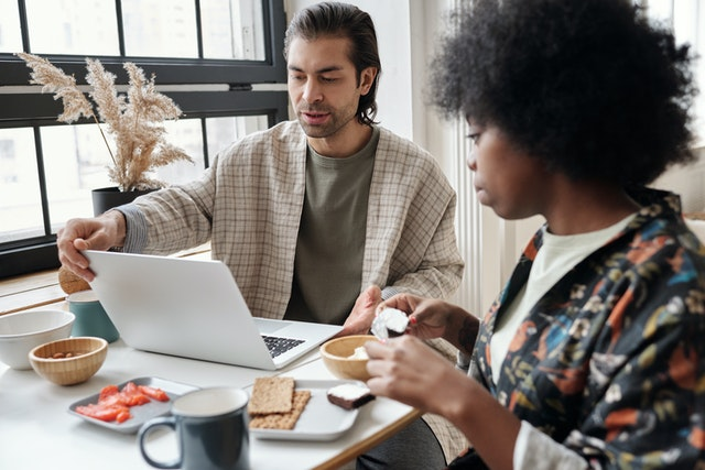 couple works at desk remote work after covid-19