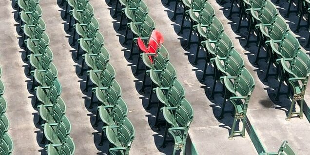 red chair standing out at ball park portfolio website tips