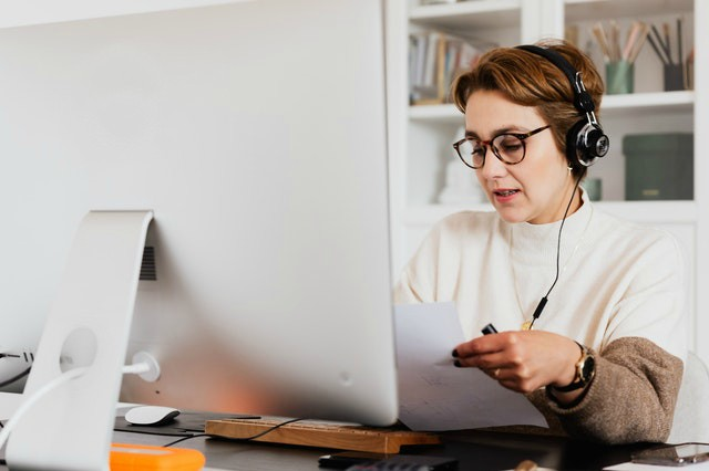 woman looking at resume while virtual interviewing